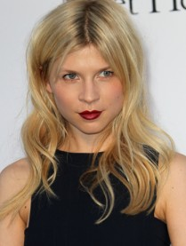 Clemence Poesy wearing a classic black dress and signature redvia Google Images